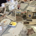 View of tabletop with papers & coffee cups
