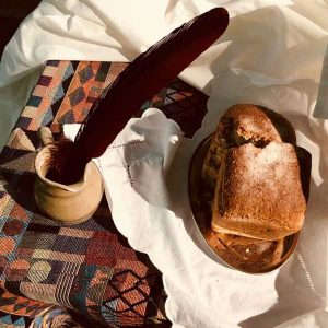 bread, wine and inkwell