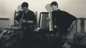 Donald playing whistle, Neil playing accordion