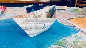 paper boat made out of maps