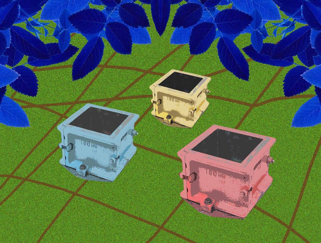 Four coloured, metal moulds (in yellow, light red and light blue), set on a green background, above which are blue leaves