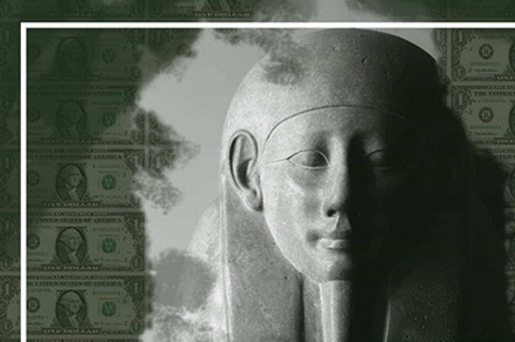 Egyptian Pharaoh sarcophagus head against a background of green US dollars with Washington's image